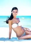 Gorgeous young girl on a summer beach Stock Photos