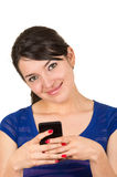 Gorgeous young girl texting with cell phone Royalty Free Stock Images