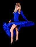 Gorgeous young lady dancing in a long blue evening dress Stock Image