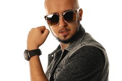 Gorgeous young macho in sunglasses posing in studio Royalty Free Stock Images