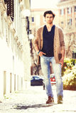 Gorgeous young men italian model outdoors, urban scene in the city Stock Photos
