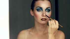Gorgeous Young model beautiful women with perfect art make up in mirror.  stock footage