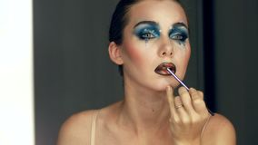 Gorgeous Young model beautiful women with perfect art make up in mirror.  stock video