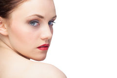 Gorgeous young model looking over shoulder Royalty Free Stock Photos