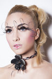 Gorgeous young model with perfect art make up and long false eyelashes Stock Image