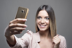 Gorgeous young modern woman taking selfie with mobile phone Royalty Free Stock Photo
