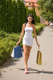 Gorgeous young shopper. Stock Photo