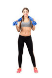 Gorgeous young sport beauty holding towel around her neck Royalty Free Stock Photography