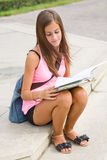 Gorgeous young student girl in the park. Royalty Free Stock Images