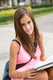 Gorgeous young student girl in the park. Stock Images