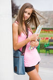 Gorgeous young student girl in the park. Royalty Free Stock Photos