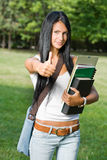 Gorgeous young student girl showing thumbs up. Stock Image