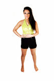 Teen girl in shorts. A gorgeous young teen girl with long black hair in a top and black shorts Stock Photo
