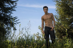 Gorgeous Young Topless Man at the Garden Royalty Free Stock Photo