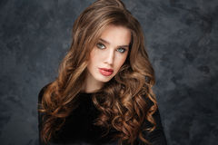 Gorgeous young woman with beautiful curly hair Royalty Free Stock Photography