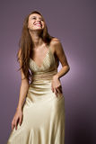 Gorgeous young woman in beautiful dress laughing Stock Images