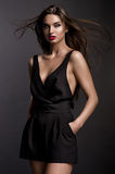 Gorgeous young woman in black outfit Royalty Free Stock Photos