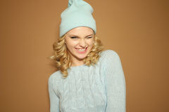 Gorgeous young woman with blond ringlets in a green knitted winter outfit Royalty Free Stock Image