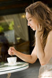 Gorgeous young woman in coffee shop. Stock Image