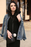 Gorgeous young woman with dark hair in casual clothes Royalty Free Stock Photography