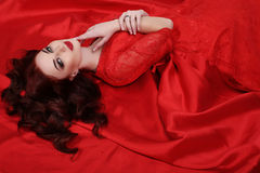Gorgeous young woman with dark hair and evening makeup, wears luxurious dress Royalty Free Stock Photo