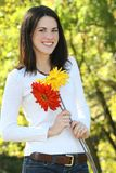 Gorgeous Young Woman with Flowers in a Park Royalty Free Stock Image
