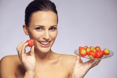 Gorgeous young woman with fresh strawberries Royalty Free Stock Image