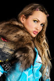 Gorgeous young woman with fur clothing Royalty Free Stock Images