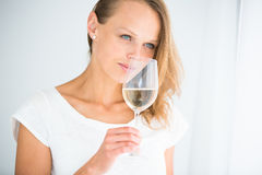 Gorgeous young woman with a glass of wine Stock Photography