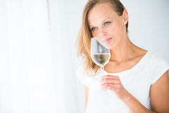 Gorgeous young woman with a glass of wine Royalty Free Stock Images