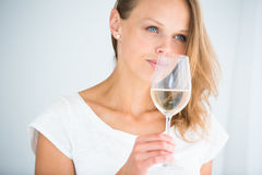Gorgeous young woman with a glass of wine Royalty Free Stock Photos