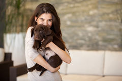 Gorgeous young woman and her puppy Royalty Free Stock Image