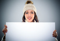Gorgeous young woman holding a blank sign Royalty Free Stock Photos