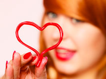 Gorgeous young woman holding candy heart. Stock Photos