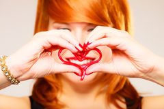 Gorgeous young woman holding candy heart. Stock Images