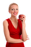 Gorgeous young woman holding a red apple Stock Images