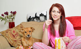 Gorgeous young woman at home with her dog Royalty Free Stock Images