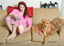 Gorgeous young woman at home with her dog Stock Photos