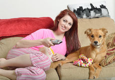 Gorgeous young woman at home with her dog Royalty Free Stock Image