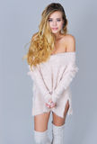 Gorgeous young woman in knitted sexy sweater Royalty Free Stock Images