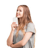 Gorgeous and young woman with light blue eyes and long straight hair holds a smart phone, isolated on a white background. stock image
