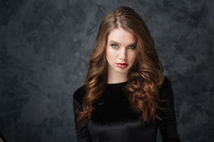 Gorgeous young woman with long curly hair Royalty Free Stock Image