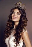 Gorgeous young woman with luxurious hair with victress crown Stock Image