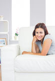 Gorgeous young woman lying on her white couch Royalty Free Stock Photos