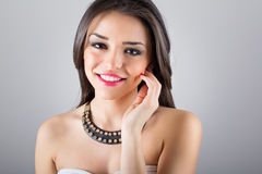 Gorgeous young woman with modern necklace Stock Photo