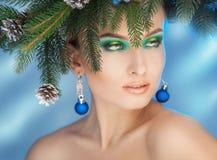 Gorgeous young woman with nice makeup looking away. Christmas ti Royalty Free Stock Photos