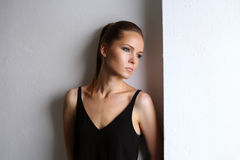 Gorgeous young woman with perfect healthy skin on white wall Stock Images