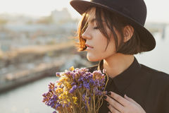 Gorgeous young woman portrait with flowers. royalty free stock image