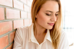 Gorgeous young woman posing with charming smile Stock Photography