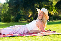 Gorgeous young woman reclining on blanket Stock Photography